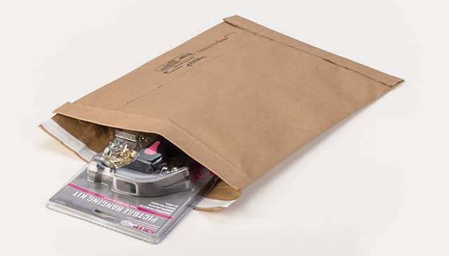A jiffy padded mailer with a picture hanging kit in it
